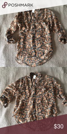 Free People: Hi-Lo Printed Button Up Floral button up with roll tab sleeves adds versatility and style to your everyday blouse. Hi-lo style updates a classic look. Brown florals work for a year round staple! Excellent condition, like new. Free People Tops Blouses