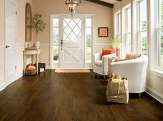 Can you believe this isn't hardwood? We can! It's Vivero™ luxury flooring with Diamond 10™ Technology, our most durable floor, in Walnut Cove - Dark Chocolate.