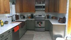 Two Tone Kitchen Sage and Oak Shaker with Entzo Calacutta Dekton Countertops and Shiplap n Dekton used for Backsplash