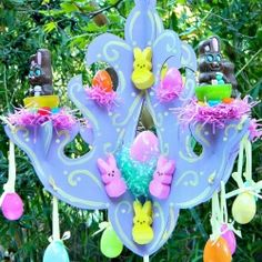 Grab the kids and some recycled cardboard and make a whimsical chocolate bunny chandelier for Easter!