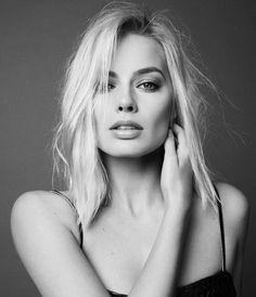 Margot Robbie. I love her as Harley Quinn... Doll Face