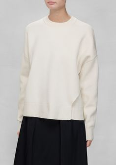 Soft and comfy, this weighty sweater is crafted from cotton. A loose fit is combined with dropped shoulders and an over-lapping asymmetric detail, for a relaxed look.