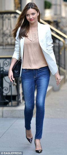 Perfectly pastel: For her day of tennis, the 30-year-old donned a pair of skin tight blue jeans, which showed off her fabulously toned legs, with a silk pastel pink flowing tank under a white suit jacket