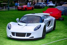 The Hennesey Venom GT went into production in 2012 by US car manufacturer Hennessey Performance Engineering. The car holds a number of world records for production cars and an unofficial record as the worlds fastest Hennessey Venom Gt, Sweet Cars, Car In The World, Car Manufacturers, Fast Cars, Car Ins, Cool Cars, Dream Cars, Automobile