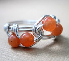 Math Jewelry Orange Wire Wrapped Ring Peach Aventurine and Sterling Silver Fibonacci Math Ring by holmescraft on Etsy https://www.etsy.com/listing/58129640/math-jewelry-orange-wire-wrapped-ring