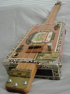 Cigar Box Guitar.  This isn't mine but I've built a couple.  I like the concept that they're super simple, yet the details matter and make the difference.