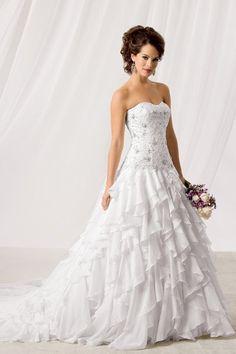 I really like ruffly wedding dresses :)  Reflections by Jordan Wedding Dresses Photos on WeddingWire