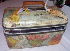Vintage Samsonite Traincase Luggage Embelleshed with a World Map by DSS Designs on Etsy.