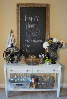cute idea with table and chalkboard. Idea for basement serving area. Keep kid oriented.