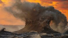 A huge wave on Lake Erie caught mid-motion by photographer Dave Sandford.
