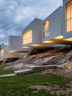 Five houses that cantilever out from a rocky hillside in Argentina.