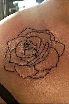 Rose outline tattoo on shoulder