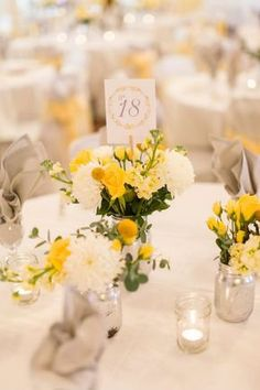 Yellow and White Centerpiece with Mums and Craspedia, , spring wedding flowers, outdoor weddings, wedding table numbers White Centerpiece, Floral Centerpieces, Wedding Centerpieces, Wedding Bouquets, Wedding Dresses, Yellow Flower Arrangements, Yellow Bouquets, Yellow Wedding Flowers, Yellow Wedding Decor