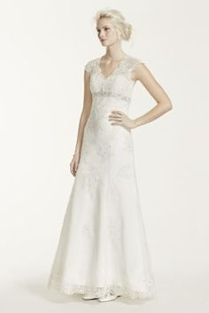"""Romantic and feminine, this A-line gown mixes subtle drama with timeless elegance.  4"""" extra length gown.  Empire waist is adorned with intricate beaded detail.  Cap sleeves add coverage while illusion lace back adds allure.  Gorgeous lace over satin fabric flows to shape a flattering A-line silhouette.  Chapel train."""
