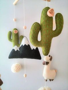 ♥️ MADE TO ORDER ♥️ This baby mobile in the style of Boho was invented by me for those who love exotic animals and decorates the childrens room in gentle, warm tones pleasant to your eye. Llama or Alpaca alternate through soft pom-poms,cacti and mountain. The mobile is fully handmade,