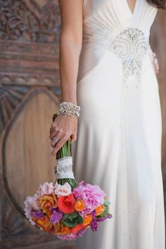 Not sure who makes this wedding gown -- so pretty!  See more on SMP, here: http://www.StyleMePretty.com/destination-weddings/2014/05/28/beach-chic-punta-mita-wedding-at-casa-amore/ Photography: KLKPhotography.com