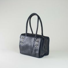 http://restored.nl/shop/bags/royal-republiq-victoria-hand-bag-cognac-or-black/ 160€