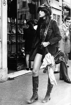 Grace Slick. The guy behind her looks impressed by her boots.