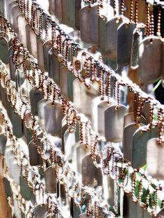 Dog tags hanging in memorial garden for fallen soldiers in Afghanistan