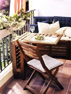 small gate leg table, folding chair with cushion, storage box with solid cushion and back support. Use deck stain on furniture to protect from rotting. Might use pallets to construct furniture.