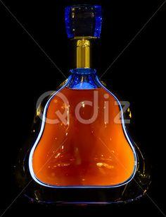 Qdiz Stock Photos | Luxury illuminated bottle with cognac or brandy,  #alcohol #alcoholic #amber #bar #beverage #bottle #brandy #bright #cafe #closeup #cognac #cold #drink #elegance #enjoyment #glamour #glassware #golden #luxury #orange #prestige #pub #relaxation #restaurant #scotch #whiskey #whisky