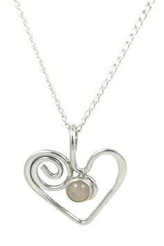 This elegant necklace has a sterling silver heart pendant with a beautiful light pink rose quartz cabochon! This original design pendant was hand crafted in Mechanicsburg PA. The sterling silver cable chain is 18 inches long. The heart measures about 3/4 inches wide.  Sterling Rose Heart by Reflections in Silver. Accessories - Jewelry - Necklaces Cleveland Ohio