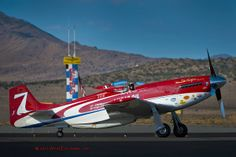 """On Sunday September 16, 2012 Steve Hinton in Highly modified P-51 Strega, Wins Gold in the """"Unlimited"""" class at the National Championship Air Races in Reno NV Photo shot using a Nikon D-800 through a Nikkor AF 200-400mm F/4.0 VR ED Lens. http://aviation.artofericjames.com/ ©2013 Eric James Swearingen www.ArtofEricJames.com #ArtofEricJames #NationalChampionshipAirRaces"""