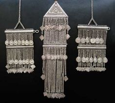 Central Asia | Three clothing ornaments | Silver | 20th century | 5,000£