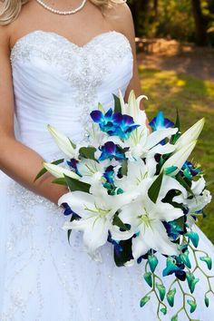 Elegant Cascading Bridal Bouquet Comprised Of: White Casablanca Lilies & Blue Dendrobium Orchids