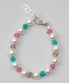 A convenient lobster claw clasp easily secures this bracelet that combines timeless pearls and crystals.