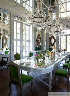 Great inspiration here. Now this is set up for a wedding but imagine it scaled down for a dining area. Love the green chairs and take it down to one chandelier. Some mirrors flanked on both sides of a buffet or side table.  well you get the idea I am sure.