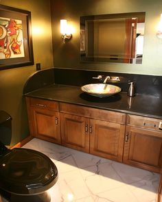 Photo Album For Website Amazing bathroom design achieved with black granite countertops large vessel sink and dark wood cabinets