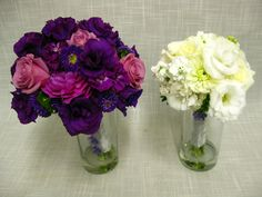 Dark purple and white wedding bouquets. The bride carried only purple while all of the girls carried only white. Flowers include dahlias, roses, lisianthus, stock and asters.