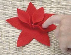 Precisa de dica para fazer algo para o Natal? Veja aqui como fazer lindas flores artificiais de feltro. O Feltro um material barato, leve e fácil de manus.