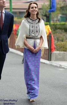 The Duchess changed into a traditional Bhutanese look, wearing a kira (also spelled as kera).