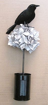 Edgar Allen Poe Topiary.  Not a huge fan, but I have a topiary made out of bookpage rosettes that would look fabulous with a black bird on top when Halloween comes around.  A raven, to be precise :)