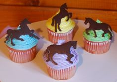 A selection of spring-themed horse cupcakes I made for the tack sale. The horses are piped chocolate.