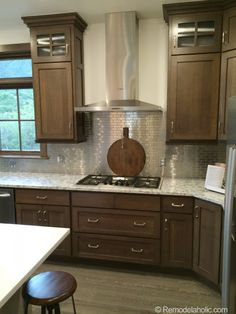 Walnut kitchen with stainless steel tile backsplash walnut kitchen cabinets, backsplash for white cabinets, Replacing Kitchen Countertops, Kitchen Cabinets, Kitchen Countertops, New Kitchen, Wood Kitchen, Walnut Kitchen, Home Kitchens, Kitchen Renovation, Walnut Kitchen Cabinets