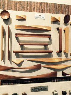Gorgeous wood cabinet pulls from Manzoni. Would look beautiful on flat painted wood drawers. Just a touch of wood.