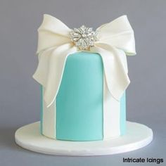 """Tiffany Blue round """"present"""" cake with fondant bow and a sugar broach"""