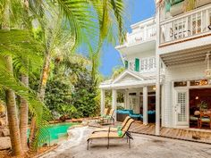 Key West house rental - The back courtyard, and the lagoon style pool with waterfall and jetting.