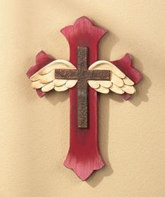 "Make a heavenly statement and give any room's decor a spiritual touch with the peaceful Angel Wing Gifts. With their beautifully textured designs, they make lovely accent pieces for a special occasion or every day. Cross, 9-7/8"" x 7-1/4"". Tree, 13-7/"
