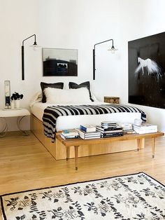 Want to create a similar look? For solid wood beds and gorgeous bedding try: www.naturalbedcompany.co.ukgraphic black + white, mural lights, oak floor / sfgirlbybay