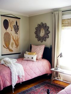 I love the mix of pink, purple, gray and gold. I love the coziness of this room.
