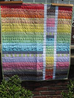 Rainbow Strip Baby Quilt.  (Link for purchasing this quilt)  Pinning this picture as the idea is so cute and very easy!  I love it!!