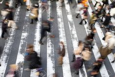 High angle view of a crowd of people walking over a pedestrian crossing with motion blur and focus to the stripes on the road Stock Photo - 51936162 walking Stock Photo
