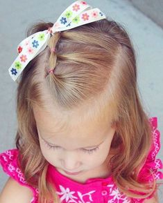 Classic toddler hairstyle on little sis...3 elastics with a bow :). Happy Saturday!