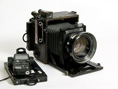 and i also want this Speed Graphic camera with an Aero Ektar lens