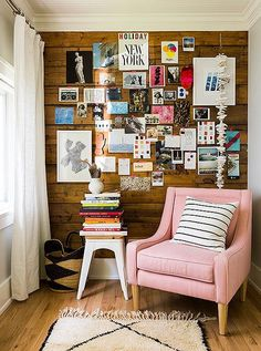 A pastel-pink slipper chair, also part of Michelle's collection, pops against the wood-paneled inspiration wall in her office.