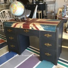 Art Deco desk/vanity reStyled with a Union Jack Flag using Chalk Paint® Decorative Paint by Annie Sloan in Graphite, Aubusson Blue, Old White, and Primer Red that is sealed with Clear Wax, and antiqued with Dark Wax.